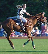 Attorney Amy Rice practices in Portsmouth, RI, a polo player and, as she appears here, a polo umpire.